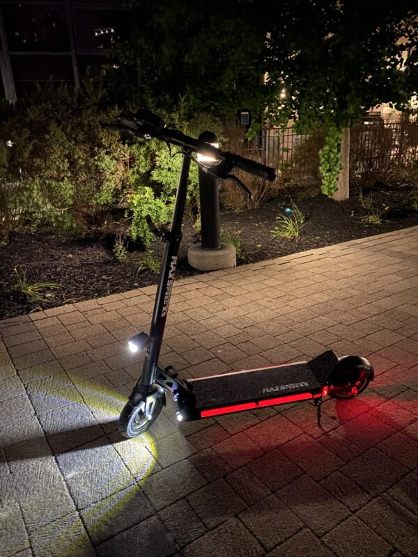 X9 E-Scooter lit up at night.