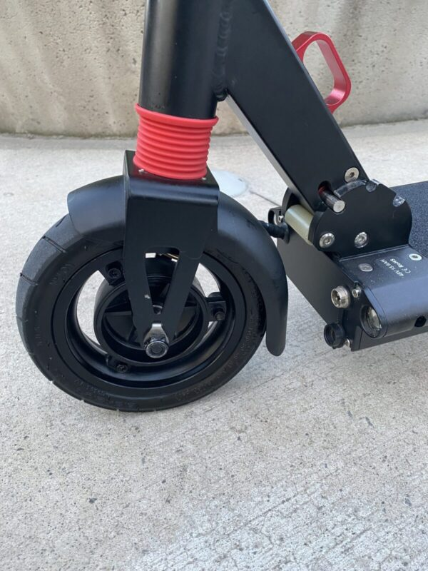 Close up of the front wheel of a Night Ryder Mini.