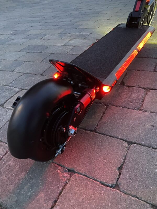 The bottom half of a Night Ryder Mini E-Scooter.