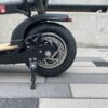 The back wheel of an Urb Ryde Exec E-Scooter.